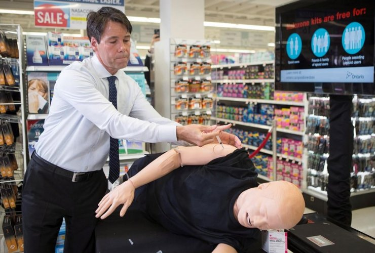 Ontario Health Minister Dr. Eric Hoskins demonstrates how to inject Naxolone, taken from an naxolone emergency kit, at a pharmacy in Toronto on Tuesday April 11 , 2017.
