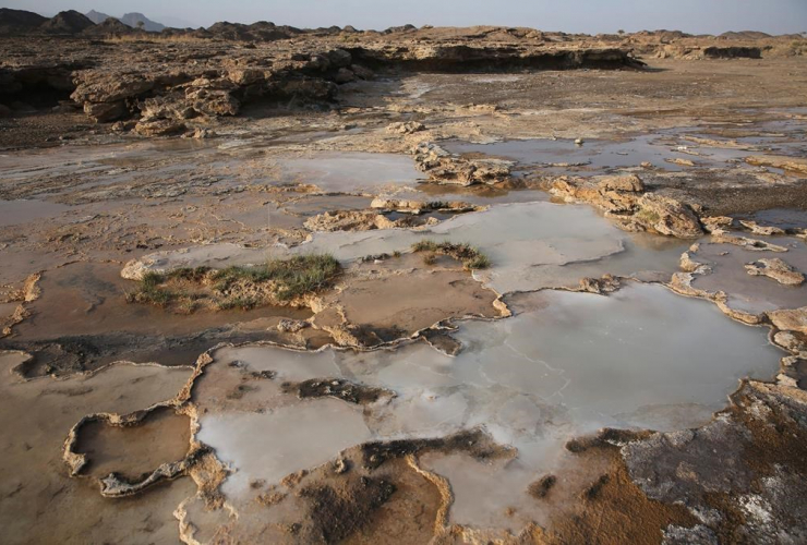 Travertine pools with white films of carbon fused with calcium