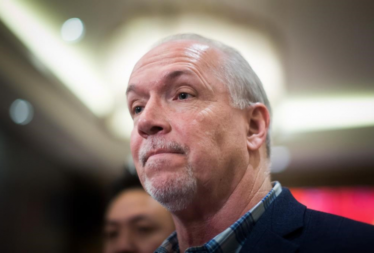 NDP Leader John Horgan listens while taking questions during a campaign stop at a Chinese restaurant in Vancouver, B.C., on Friday April 14, 2017.