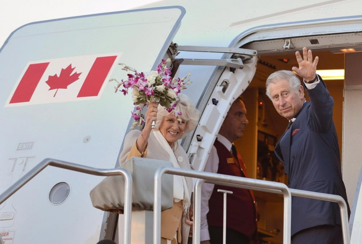 Prince Charles and his wife Camilla wave as they leave Winnipeg on May 21, 2014.