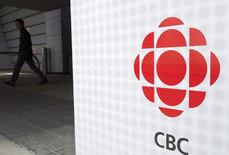 A man leaves the CBC building in Toronto on April 4, 2012.