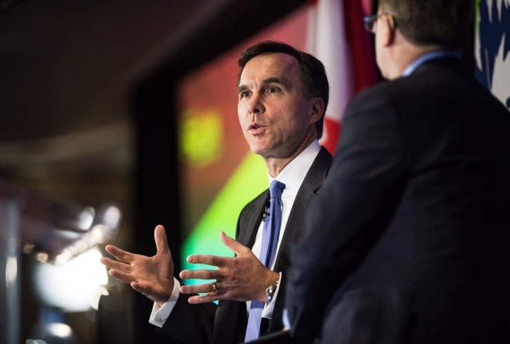 Finance Minister Bill Morneau speaks with Edward Greenspon at The Public Policy Forum Growth Summit in Toronto on Thursday, April 20, 2017.