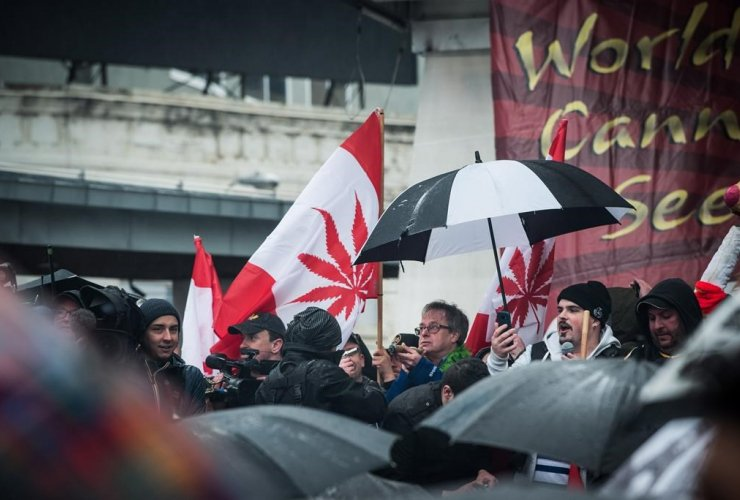 Mark Emery smokes during the 4/20 celebration at Yonge and Dundas Square in downtown Toronto on Thursday, April 20, 2017.