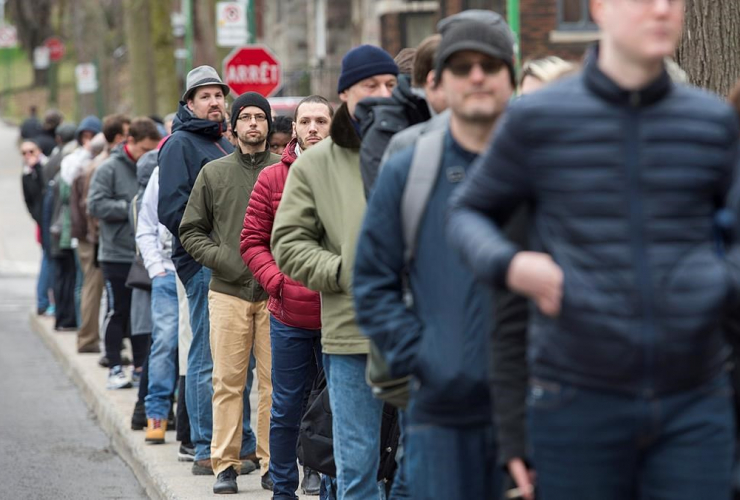 French expats wait in line to vote in Montreal, Saturday, April 22, 2017.