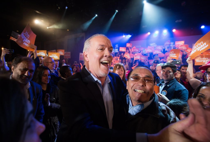 P Leader John Horgan greets supporters before speaking during a campaign rally in Vancouver, B.C., on Sunday April 23, 2017.