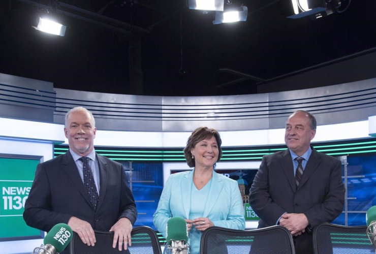 B.C. NDP leader John Horgan, left to right, Liberal Leader Christy Clark and B.C. Green Party leader Andrew Weaver pose for a photo following the leaders radio debate in Vancouver, B.C., April 20, 2017.