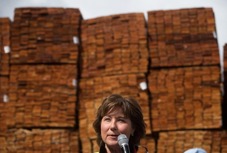 Liberal Leader Christy Clark addresses workers and local candidates while standing in front of stacks of western red cedar wood during a campaign stop at CedarLine Industries, a manufacturer of western red cedar products, Surrey, B.C., on April 24, 2017