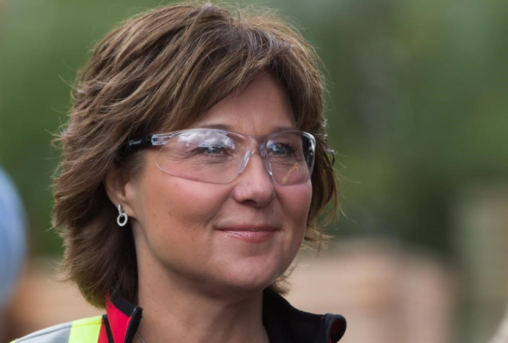 Liberal Leader Christy Clark wears safety glasses during a campaign stop at CedarLine Industries, a manufacturer of western red cedar products, in Surrey, B.C., on Monday April 24, 2017.