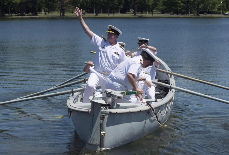Norman waves goodbye as he is traditionally rowed away in a whaler after stepping down as the head of the Royal Canadian Navy in a ceremony Thursday, June 23, 2016 in Ottawa. File photo by The Canadian Press/Adrian Wyld