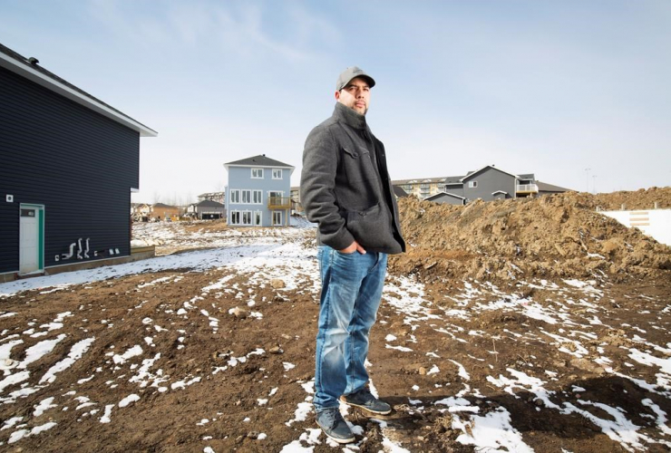 Farid El-Hayouni on Prospect Drive where his old house burned down during the wildfires last year in Fort McMurray, Alta. Friday, April 21, 2017. File photo by The Canadian Press/Todd Korol