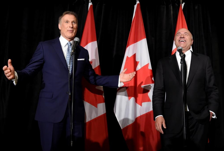 Conservative Party leadership candidate Maxime Bernier (left) gestures as Kevin O'Leary looks on at a news conference in Toronto, on April 26, 2017, after it was announced that O'Leary had quit the leadership race and thrown his support behind Bernier.