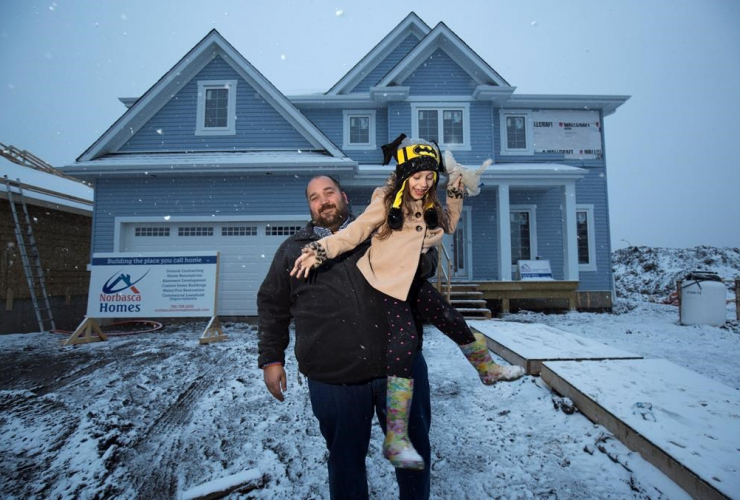 Chris Flett and his daughterJessica are shown at his new Beacon Hill house after it was rebuilt after losing it to the wildfires last year in Fort McMurray, Alta., Thursday, April 20, 2017. THE CANADIAN PRESS/Todd Korol