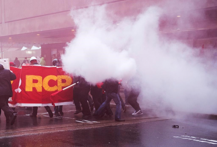 A smoke bomb goes off during a May Day demonstration Monday, May 1, 2017 in Montreal.