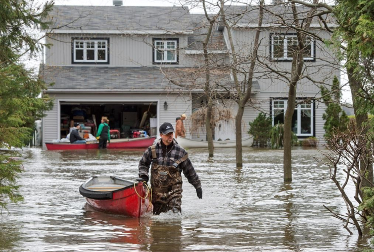 Residents use canoes to access their home Monday, May 8, 2017 in Deux-Montagnes, Quebec.
