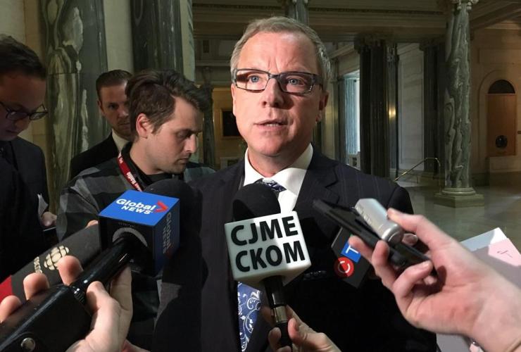 Saskatchewan Premier Brad Wall talks to reporters at the legislature in Regina, Monday, May 1, 2017.