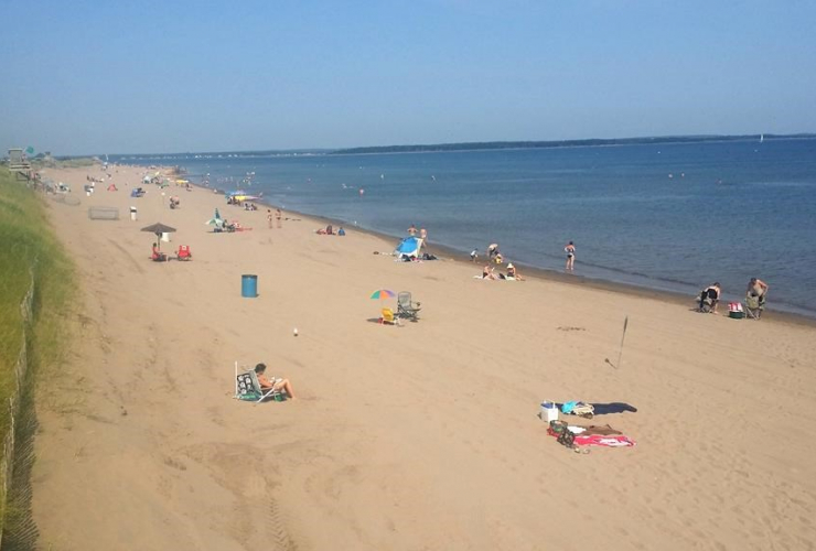 People are shown on Parlee Beach, Shediac, N.B. in this undated image. Handout photo by Tourism New Brunswick