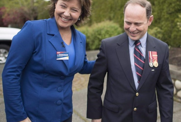B.C. Liberal leader Christy Clark shares a laugh with local candidate Jim Benninger during a campaign stop in Courtney, B.C., on Monday, May 8, 2017. File photo by The Canadian Press/Jonathan Hayward