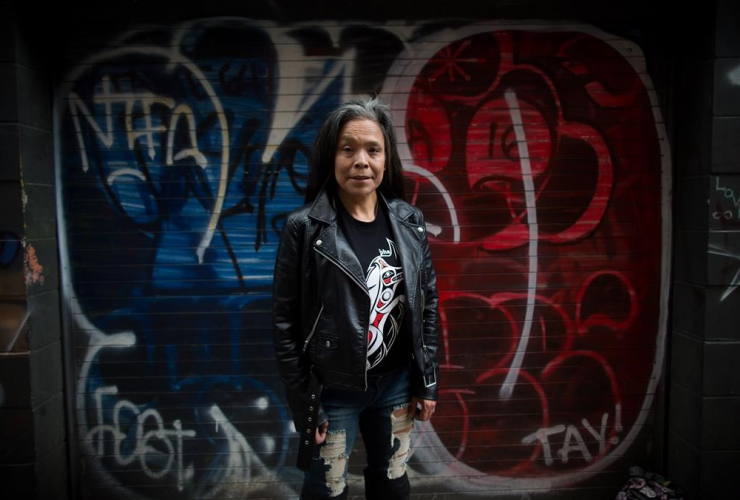 Maggy Gisle stands for a photograph in the Downtown Eastside of Vancouver, B.C., on Tuesday, May 9, 2017.