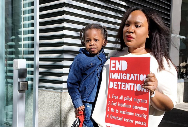 Kimora Adetunji, 33, is seen with her son King, 2, outside Federal Court in Toronto on Monday, May 15, 2017, where indefinite immigration detention was subject of a court hearing.