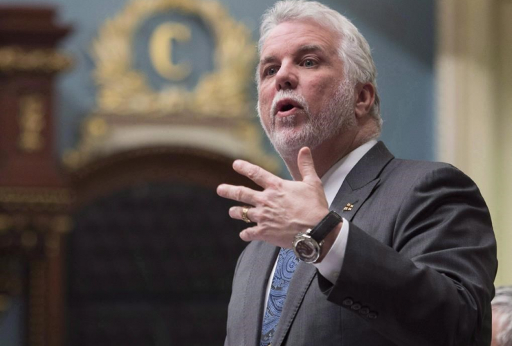 Quebec Premier Philippe Couillard responds to Opposition questions over former premier Jean Charest and Marc Bibeau, during question period Tuesday, April 25, 2017 at the legislature in Quebec City.