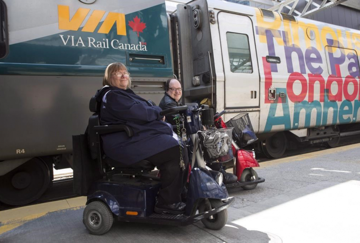 Martin Anderson and Marie Murphy are pictured in front of a Via Rail train at Toronto's Union Station on Saturday May 13, 2017.