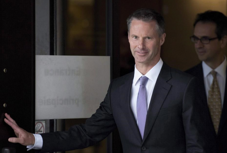 Nigel Wright, former Chief of Staff to Prime Minister Stephen Harper, leaves the courthouse in Ottawa following his sixth day of testimony at the trial of former Conservative Senator Mike Duffy on Aug. 19, 2015.