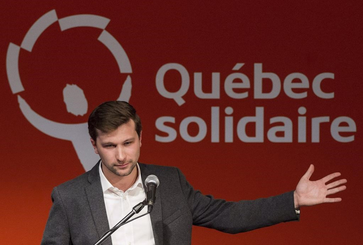Gabriel Nadeau-Dubois speaks to supporters during an event in Montreal, Sunday, March 26, 2017, announcing him as Quebec Solidaire's nominee for the riding of Gouin in an upcoming byelection. File photo by The Canadian Press/Graham Hughes