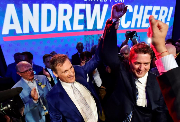 Andrew Scheer, right, is congratulated by Maxime Bernier after being elected the new leader of the federal Conservative party at the federal Conservative leadership convention in Toronto on Saturday, May 27, 2017.