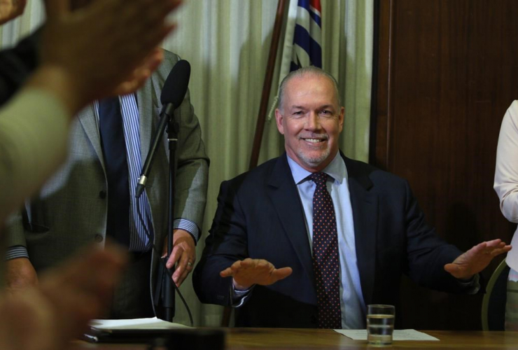 B.C. NDP leader John Horgan delivers opening remarks to the New Democrat caucus before reviewing the agreement during a press conference at Legislature in Victoria, B.C., on Tuesday, May 30, 2017.