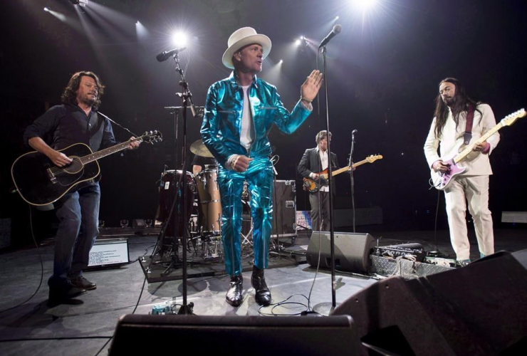 Tragically Hip frontman Gord Downie, centre, leads the band through a concert in Vancouver, Sunday, July 24, 2016.