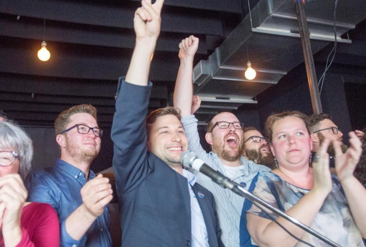 Quebec Solidaire candidate Gabriel Nadeau-Dubois, centre, reacts after winning the provincial byelection in the Montreal riding of Gouin on Monday, May 29, 2017.