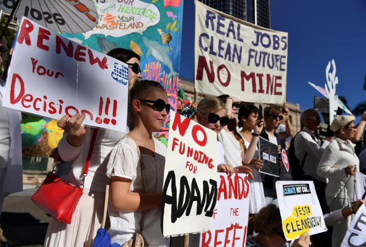In this May 25, 2017 photo, environmental activists voice their opposition to Indian miner Adani's proposed Carmichael coal mine, outside Parliament House in Brisbane, Australia. File photo by The Associated Press