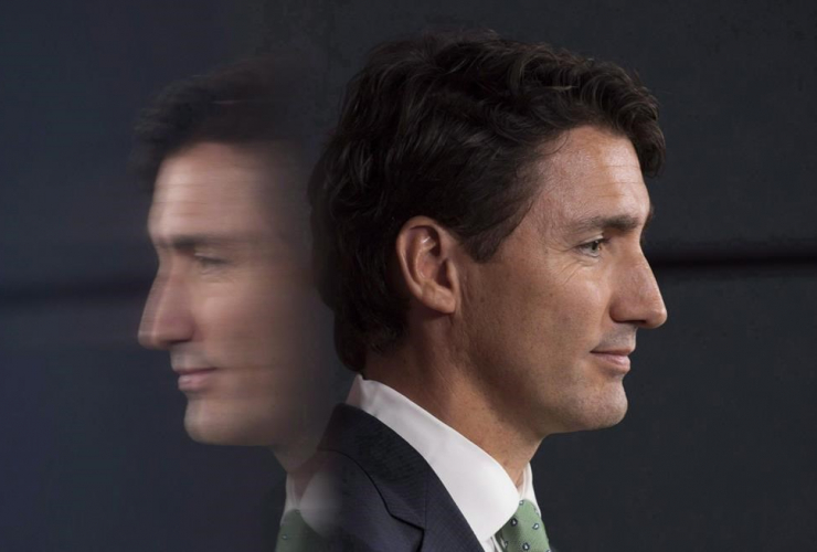 Prime Minister Justin Trudeau is reflected in a television as he listens to a question during a news conference in Ottawa, Wednesday September 21, 2016.