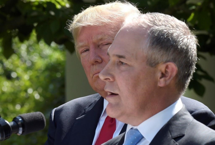 President Donald Trump listens as EPA Administrator Scott Pruitt speaks in the Rose Garden of the White House in Washington, on June 1, 2017