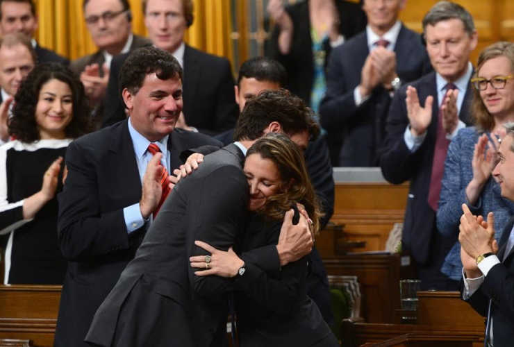 Minister of Foreign Affairs Chrystia Freeland is congratulated by Prime Minister Justin Trudeau and party members after delivering a speech in the House of Commons on Canada's Foreign Policy in Ottawa on June 6, 2017.