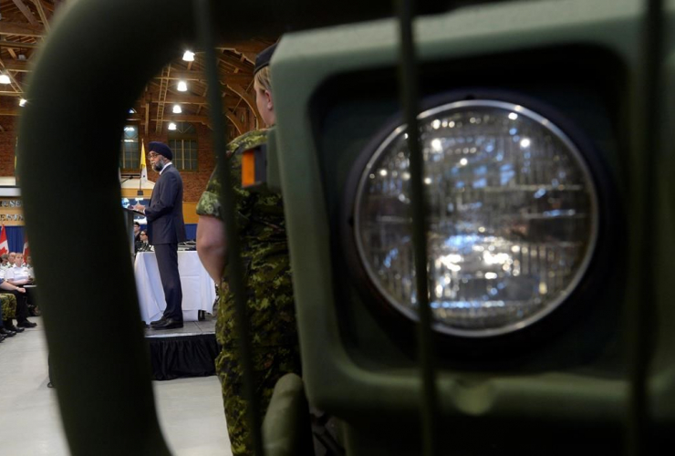 Framed by a military vehicle Defence Minister Harjit Sajjan unveils the Liberal government's long-awaited vision for expanding the Canadian Armed Forces in Ottawa on Wednesday, June 7, 2017.