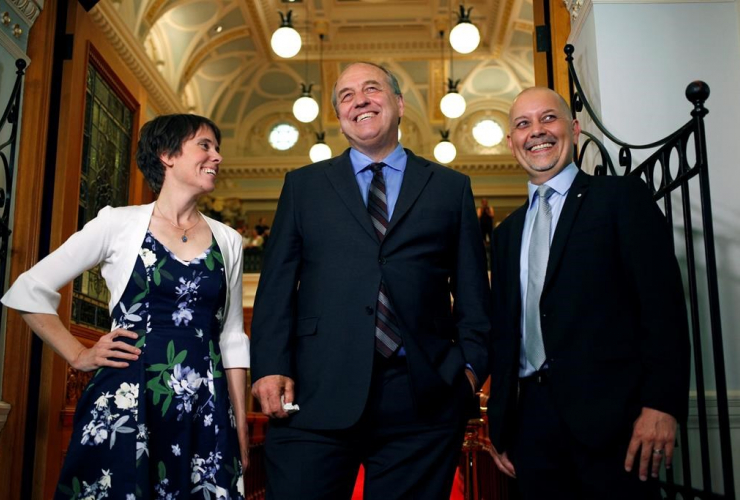 B.C. Green Caucus elected MLA's Sonia Furstenau, Andrew Weaver and Adam Olsen wait outside the legislative assembly before officially being sworn in as members during a ceremony at Legislature in Victoria, B.C., on June 7, 2017.