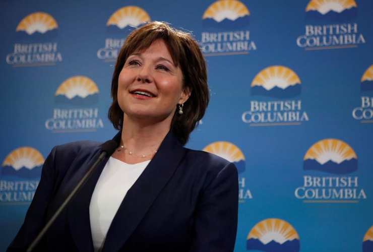 B.C. Premier Christy Clark talks with media after being sworn in as premier following a ceremony at Legislature in Victoria, B.C., on Thursday, June 8, 2017.