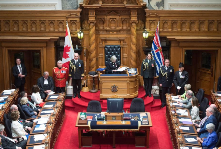 British Columbia Premier Christy Clark, left, and NDP leader John Horgan, right, look on as B.C. Lieutenant Governor Judith Guichon gives the Speech from Throne in Victoria, on Thursday, June 22, 2017.