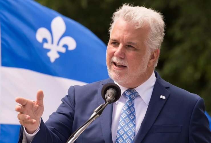 Quebec Premier Philippe Couillard speaks at a ceremony marking the Fete Nationale, on Thursday, June 22, 2017 in Quebec City.