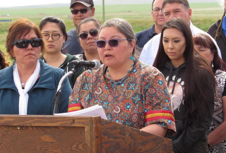 Deputy superintendent Annette Bruisedhead of the Blood Tribe in southern Alberta speaks to reporters in Standoff, Alta., on Thursday, June 22, 2017.