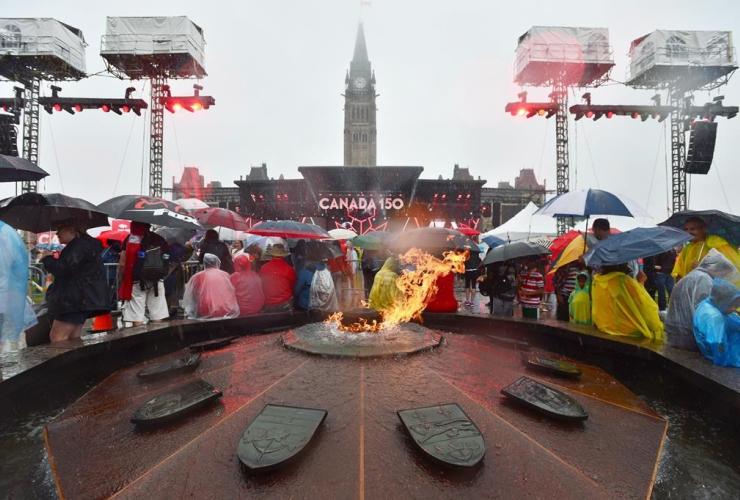 People, rain, Parliament Hill, Centennial Flame, Ottawa, Canada 150