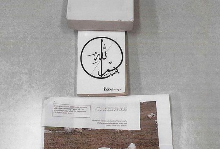 package, Centre Culturel Islamique de Quebec, defaced Qur'an