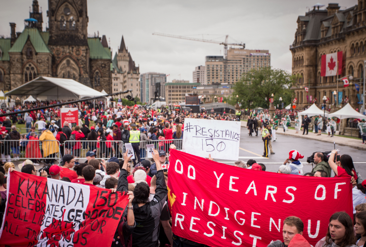 People protest during Canada 150 celebrations in Ottawa on July 1, 2017.