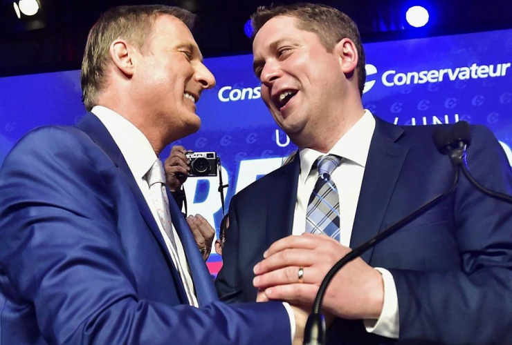 Maxime Bernier and Andrew Scheer at the federal Conservative leadership convention in Toronto on Saturday, May 27, 2017. Photo by The Canadian Press/Frank Gunn