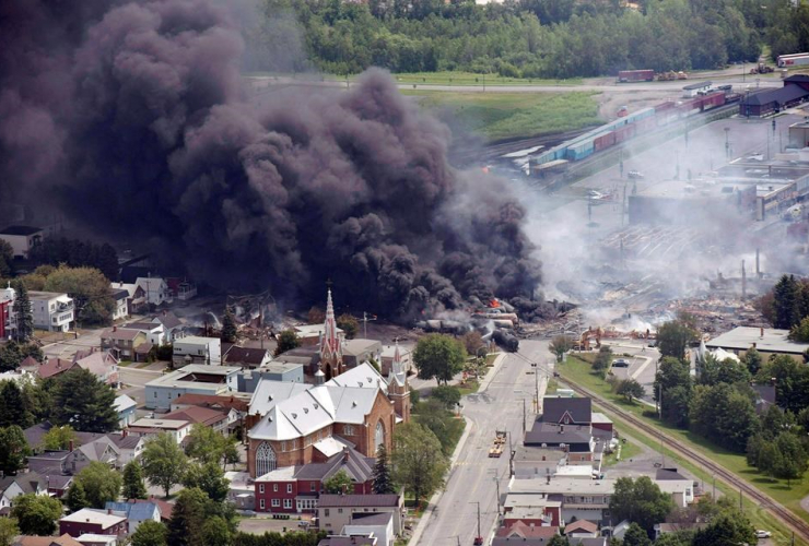 smoke, railway cars, crude oil, derailing, downtown Lac Megantic, Que.,