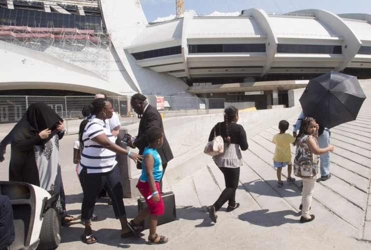 group, asylum seekers, Olympic Stadium, Montreal,