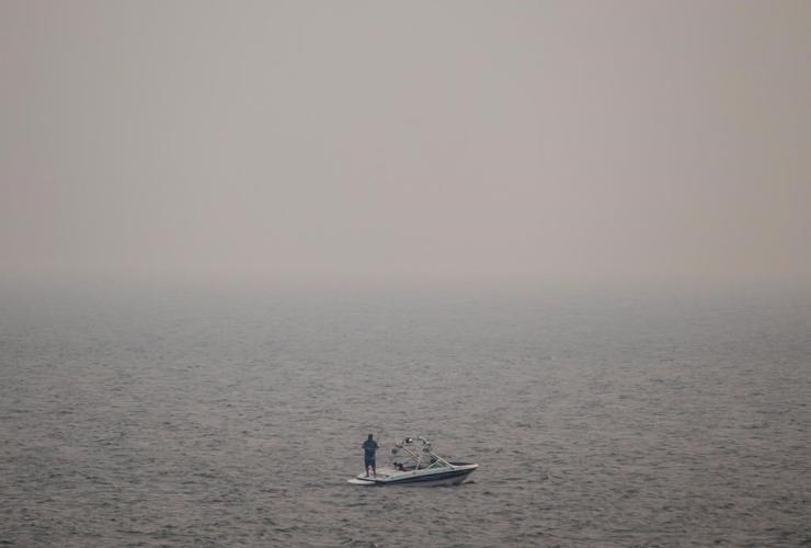 Thick smoke, wildfires, boat, fishing, Kamloops Lake,