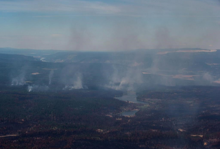 Smoke, wildfires, burned trees, aerial view, Canadian Forces, Chinook helicopter, Williams Lake, B.C.,