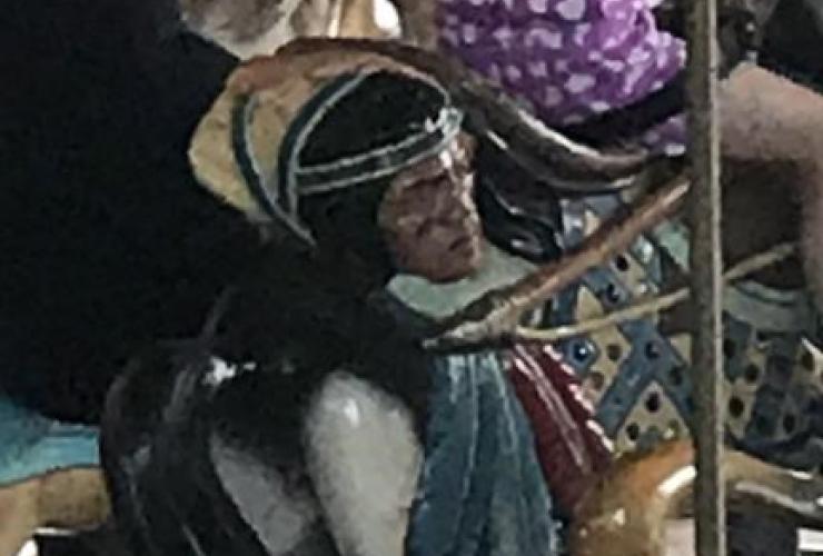 Montreal, La Ronde amusement park, carousel horse, Indigenous man, severed head,